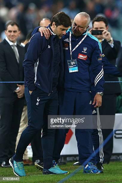 Sydney FC coach Graham Arnold embraces Hotspurs coach Mauricio Pochettino following the international friendly match between Sydney FC and Tottenham...