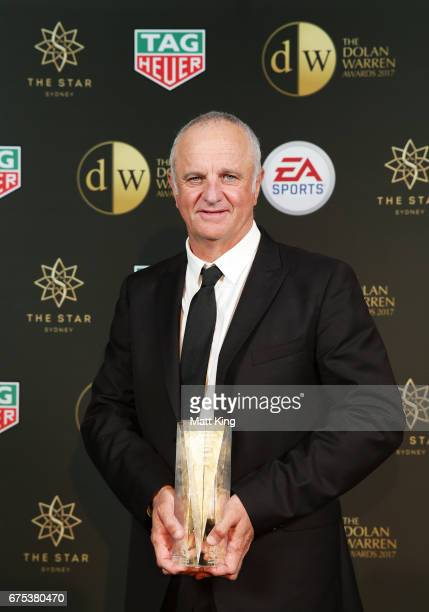 Sydney FC coach Graham Arnold poses with the ALeague Coach of the Year award during the FFA Dolan Warren Awards at The Star on May 1 2017 in Sydney...