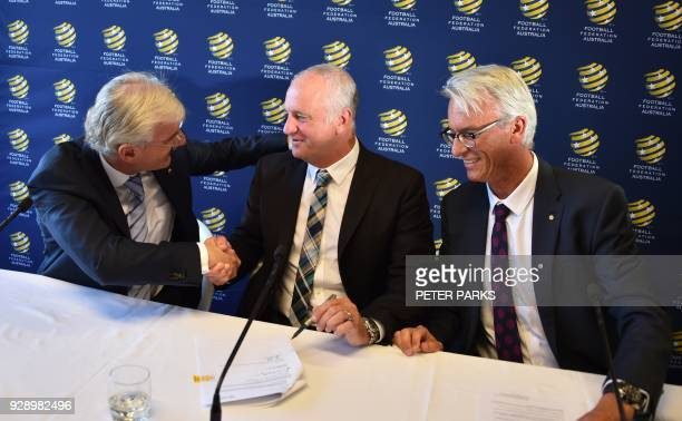 Sydney FC coach Graham Arnold shakes hands with Football Federation Australia chairman Steven Lowy and Chief Executive Officer David Gallop after he...