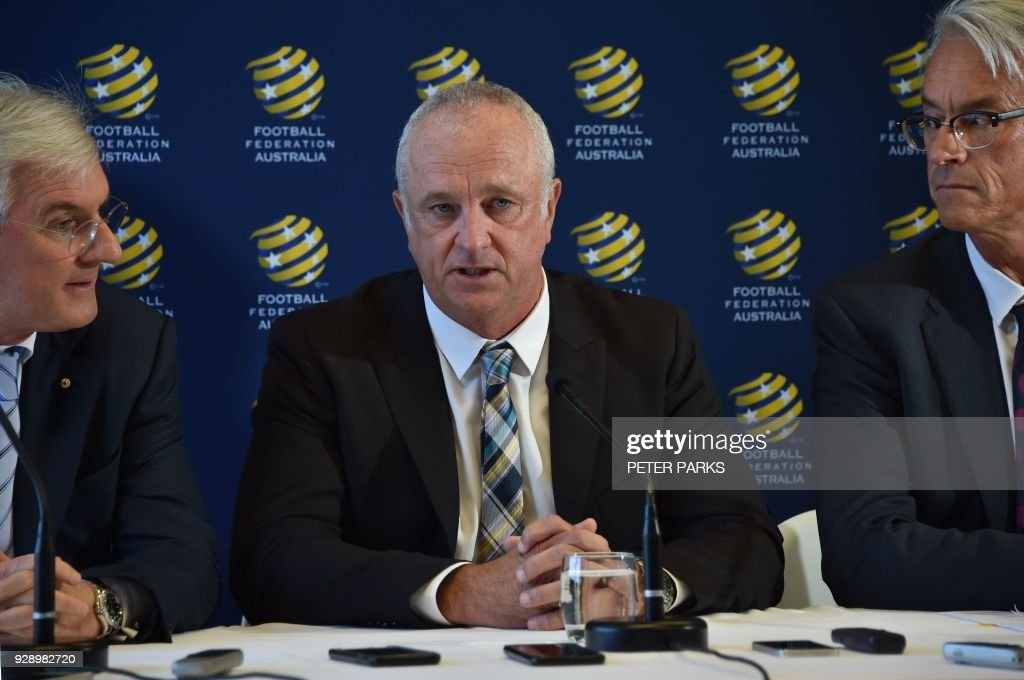 Sydney FC coach Graham Arnold (C) speaks at a press conference flanked by Football Federation Australia chairman Steven Lowy (L) and Chief Executive Officer David Gallop (R) after he was announced Australia soccer team coach in Sydney on March 8, 2018. Arnold will take over as Australia coach after the World Cup 2018, replacing Dutchman Bert van Marwijk who was hired on a short-term basis to guide the team in Russia, football officials announced. /