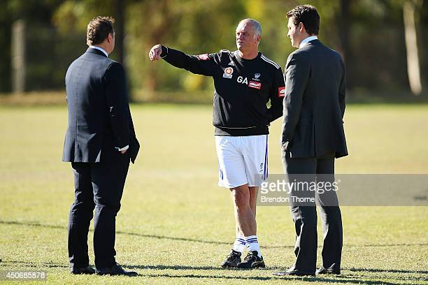 Sydney FC Coach Graham Arnold speaks with Sydney Chairman Scott Barlow and Sydney FC CEO Tony Pignata during a Sydney FC ALeague training session at...
