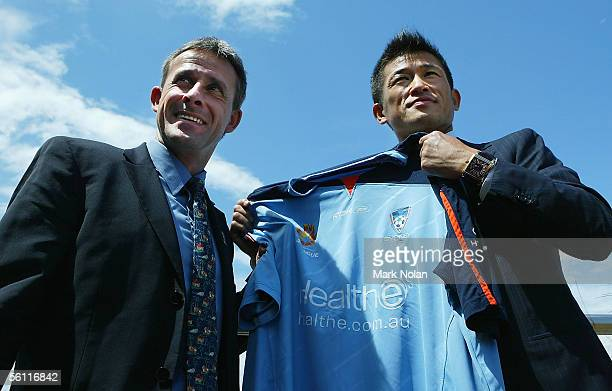 Sydney FC coach Pierre Littbarski and Japanese footballer Kazuyoshi Miura pose with a club shirt following the Sydney FC press conference at Star...