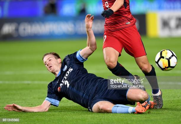Sydney FC defender Aaron Calver clears the ball from Kashima Antlers forward Yuma Suzuki during their AFC Champions League Group H football match at...