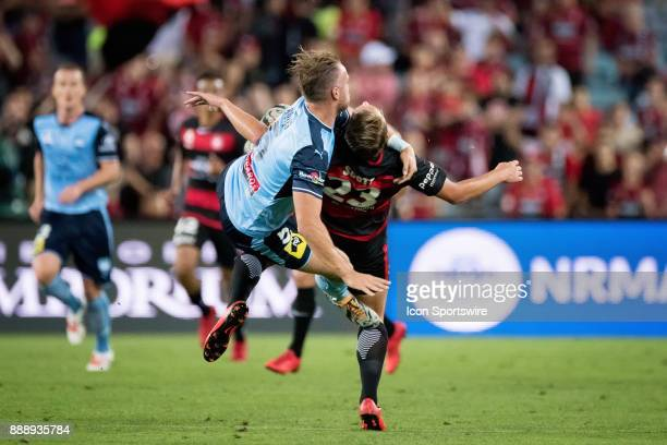 Sydney FC defender Jordy Buijs and Western Sydney Wanderers Lachlan Scott come together at the Hyundai ALeague match between Western Sydney Wanderers...