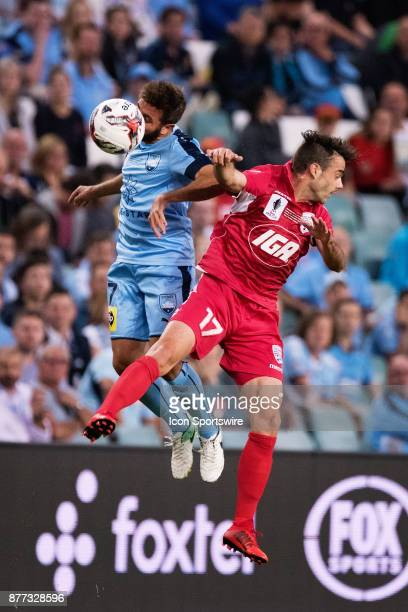 Sydney FC defender Michael Zullo and Adelaide United forward Nikola Mileusnic go up for the ball at the FFA Cup Final Soccer between Sydney FC and...