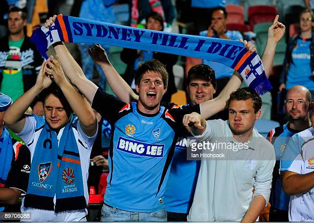 Sydney FC fans celebrate after winning round one ALeague match between the North Queensland Fury and Sydney FC at Dairy Farmers Stadium on August 8...
