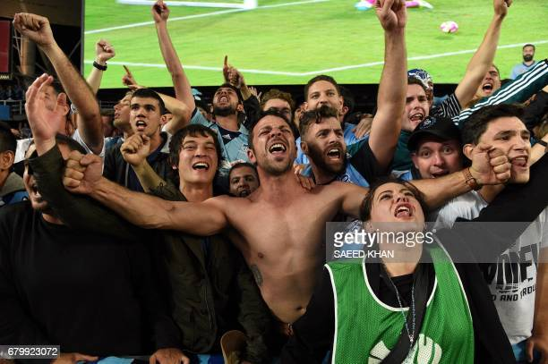 Sydney FC fans celebrate their team's victory in the 2017 ALeague Grand Final football match against Melbourne Victory at Allianz Stadium in Sydney...
