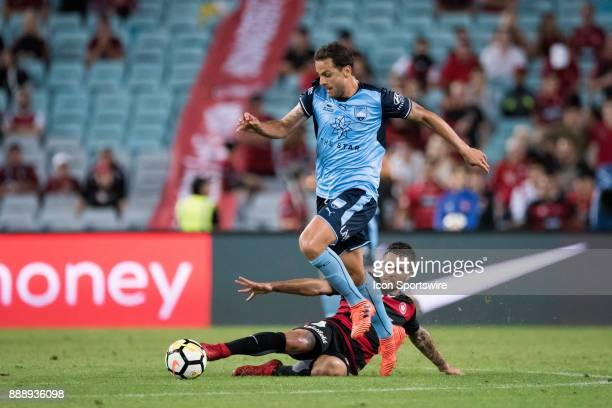 Sydney FC forward Bobo gets the ball past Western Sydney Wanderers defender Josh Risdon at the Hyundai ALeague match between Western Sydney Wanderers...