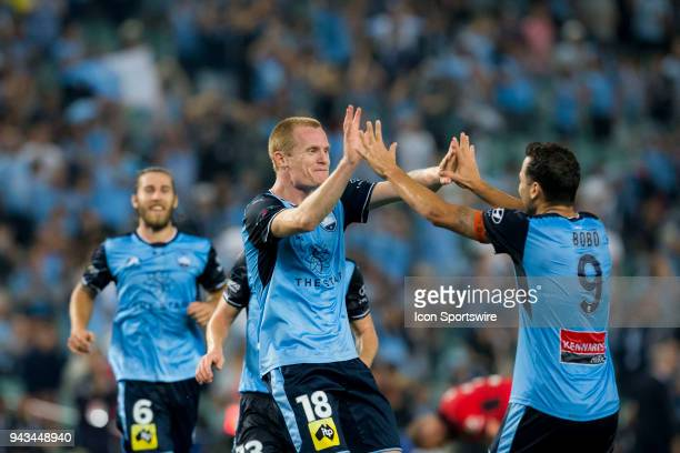 Sydney FC forward Matt Simon celebrates his goal with teammate Bobo at the ALeague Soccer Match between Sydney FC and Adelaide United on April 8 2018...