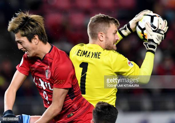 Sydney FC goalkeeper Andrew Redmayne catches the ball beside Kashima Antlers forward Yuma Suzuki during their AFC Champions League Group H football...