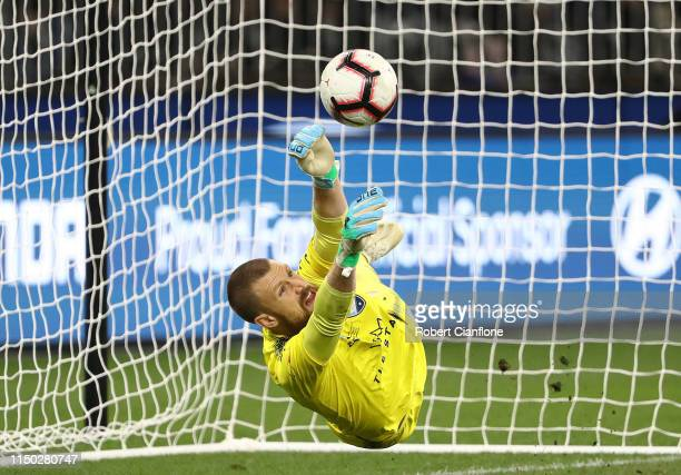 Sydney FC goalkeeper Andrew Redmayne makes a save to deny Andy Keogh of Perth Glory in the penalty shoot out during the 2019 A-League Grand Final...
