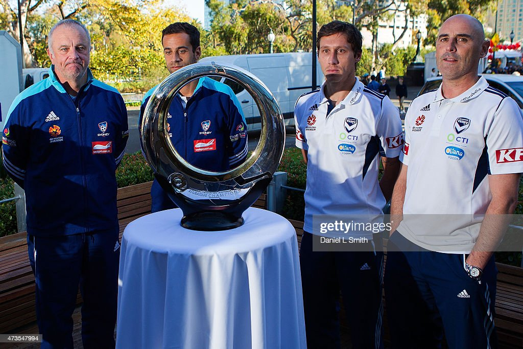 Sydney FC Head Coach Graham Arnold and Captain, Alex Brosque with Melbourne Victory Head Coach, Kevin Muscat and Captain, Mark Milliganspeaks during the A-League Grand Final press conference at Federation Square on May 16, 2015 in Melbourne, Australia.