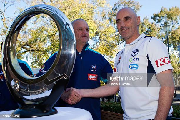 Sydney FC Head Coach Graham Arnold and Melbourne Victory Head Coach Kevin Muscat shake hands during the ALeague Grand Final press conference at...