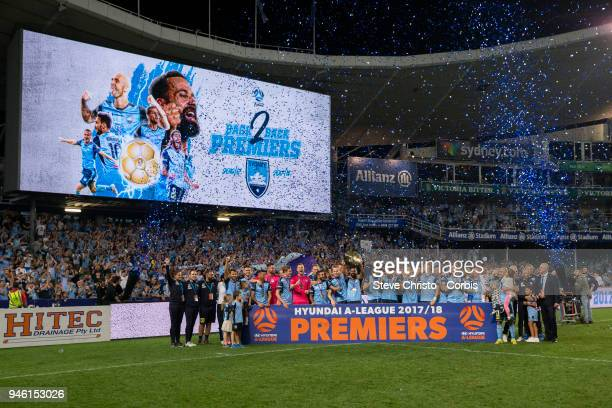 Sydney FC hold up the Premiers Plate after the round 27 ALeague match between the Sydney FC and the Melbourne Victory at Allianz Stadium on April 13...