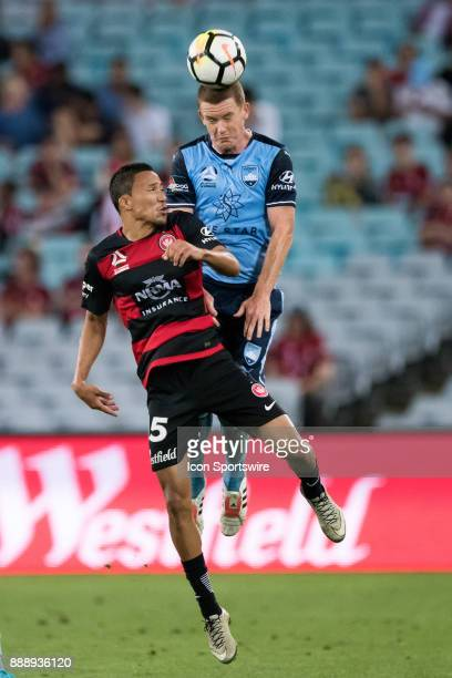 Sydney FC midfielder Brandon O'Neill and Western Sydney Wanderers defender Brendan Hamill go up for the ball at the Hyundai ALeague match between...