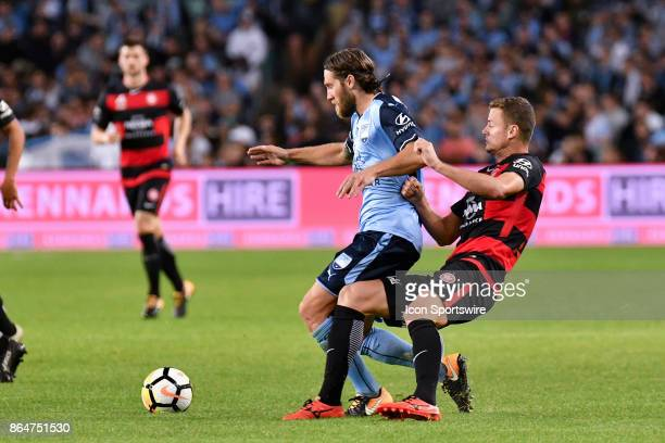 Sydney FC midfielder Joshua Brillante and Western Sydney Wanderers defender Josh Risdon fight for the ball at the Hyundai ALeague match between...