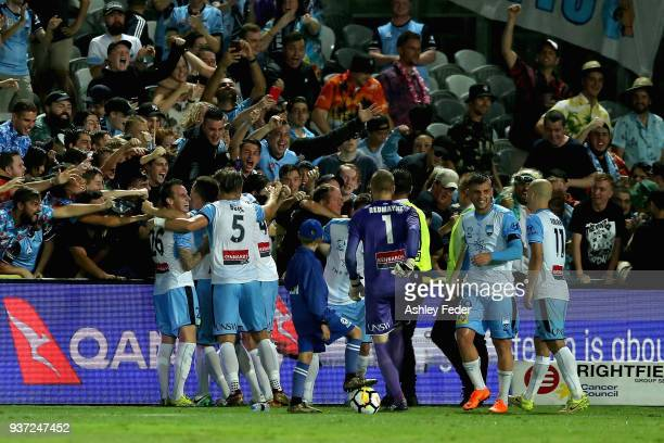 Sydney FC players and fans celebrate the winning goal during the round 24 ALeague match between the Central Coast Mariners and Sydney FC at Central...