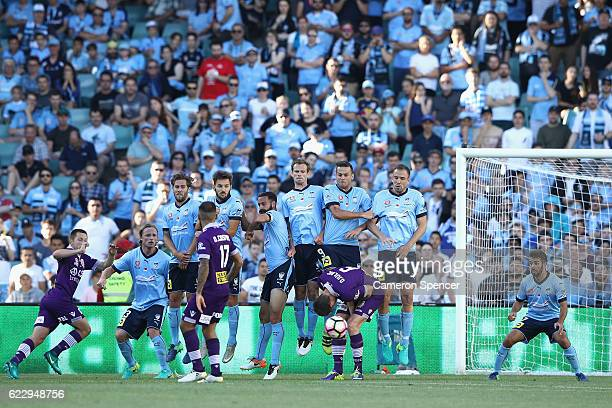 Sydney FC players attempt to block a penalty shot at goal during the round six ALeague match between the Sydney Kings and the Perth Widcats at...
