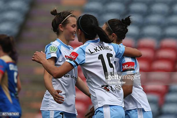 Sydney FC players celebrate a goal during the round five WLeague match between the Newcastle Jets and Sydney FC at McDonald Jones Stadium on December...