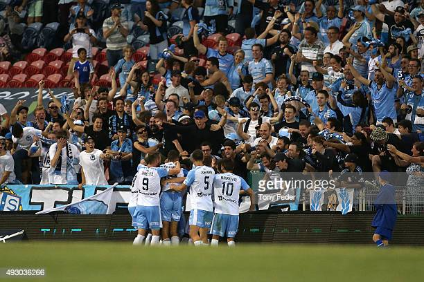 Sydney FC players celebrate a goal during the round two A-League match between the Newcastle Jets and Sydney FC at Hunter Stadium on October 17, 2015...