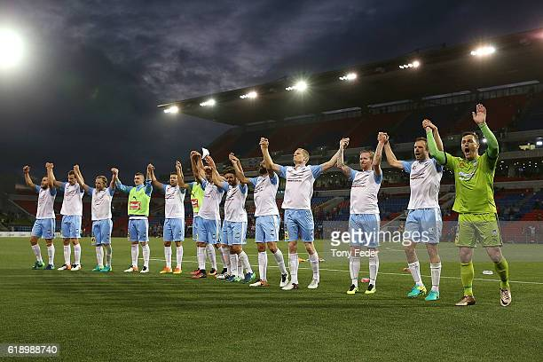 Sydney FC players celebrate after beating the Jets during the round four ALeague match between the Newcastle jets and Sydney FC at McDonald Jones...