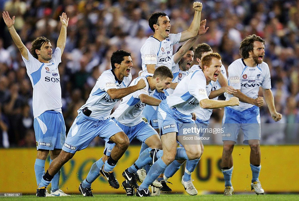 Sydney FC players celebrate after winning the penalty shoot-out for victory during the A-League Grand Final match between the Melbourne Victory and Sydney FC at Etihad Stadium on March 20, 2010 in Melbourne, Australia.