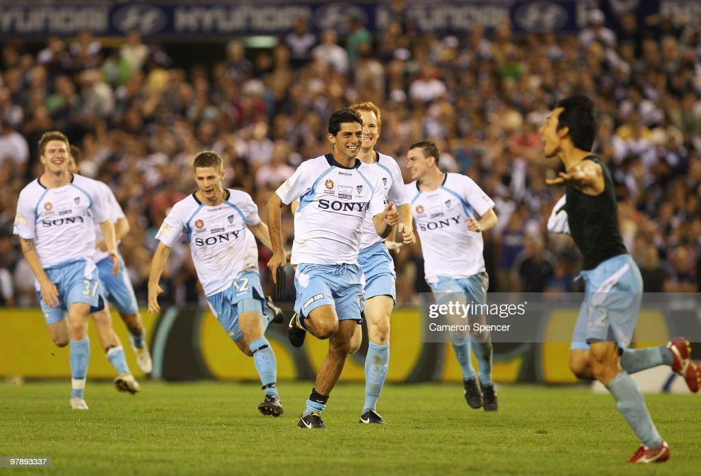 Sydney FC players celebrate and run towards team mate Sung-Hwan Byun after winning the penalty shootout in extra time during the A-League Grand Final match between the Melbourne Victory and Sydney FC at Etihad Stadium on March 20, 2010 in Melbourne, Australia.
