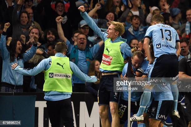 Sydney FC players celebrate their first goal against Melbourne Victory during the 2017 ALeague Grand Final football match at Allianz Stadium in...