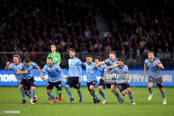 Sydney FC players celebrate winning during the penalty shootout following extra time in the 2019 ALeague Grand Final match between the Perth Glory...