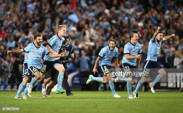Sydney FC players celebrate winning the 2017 ALeague Grand Final match between Sydney FC and the Melbourne Victory at Allianz Stadium on May 7 2017...