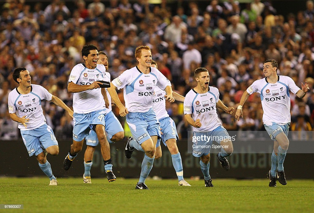 Sydney FC players celebrate winning the penalty shootout in extra time during the A-League Grand Final match between the Melbourne Victory and Sydney FC at Etihad Stadium on March 20, 2010 in Melbourne, Australia.