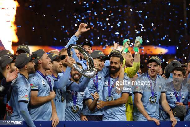 Sydney FC players celebrate with the trophy after winning the 2019 ALeague Grand Final match between the Perth Glory and Sydney FC at Optus Stadium...