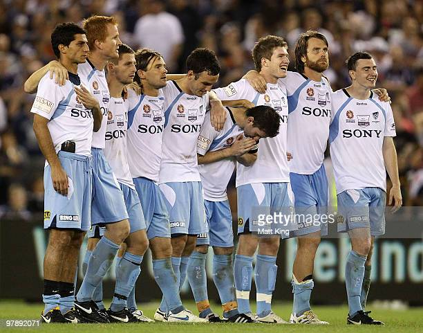 Sydney FC players line up before the final penalty shootout attempt of Sung_Hwan Byun during the ALeague Grand Final match between the Melbourne...