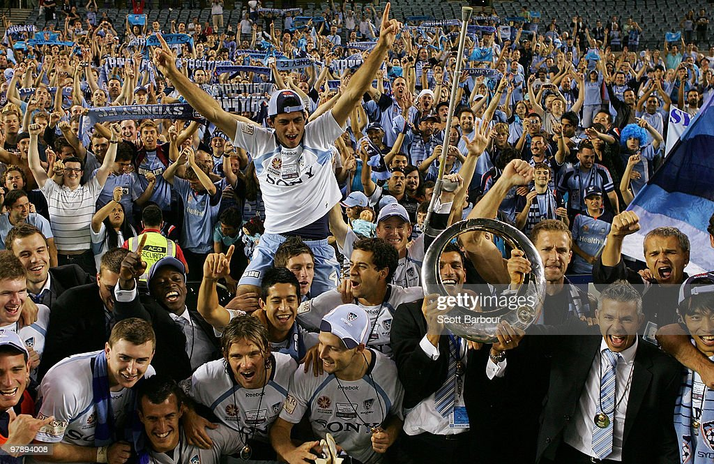 Sydney FC players pose for a team shot with Sydney fans after winning the A-League Grand Final match between the Melbourne Victory and Sydney FC at Etihad Stadium on March 20, 2010 in Melbourne, Australia.