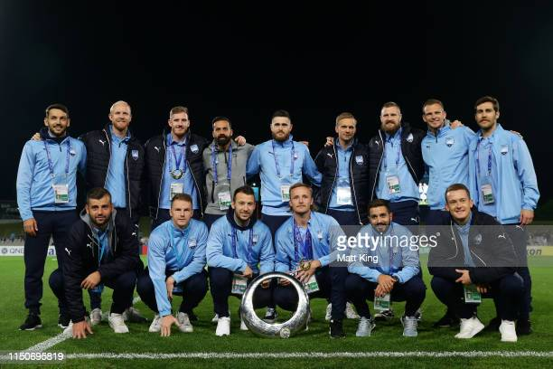 Sydney FC players pose with the ALeague trophy before the AFC Asian Champions League match between Sydney FC and Kawasaki Frontale at Jubilee Stadium...