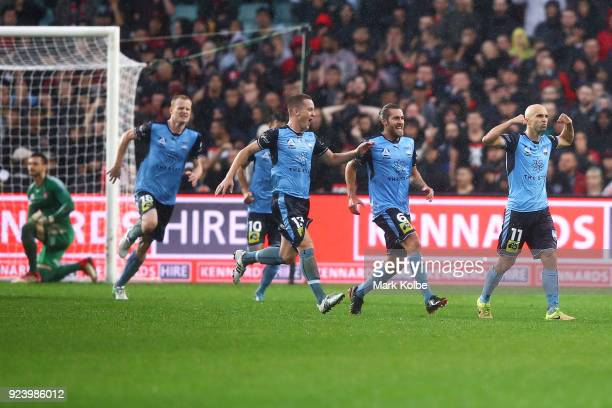 Sydney FC players runs to congratulate Adrian Mierzejewski of Sydney FC as he celebrates scoring a goal during the round 21 ALeague match between...