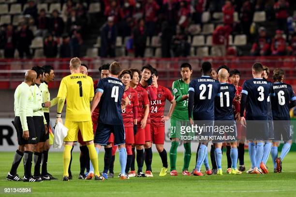 Sydney FC players shake hands with Kashima Antlers players after their AFC Champions League Group H football match at Kashima soccer stadium in...