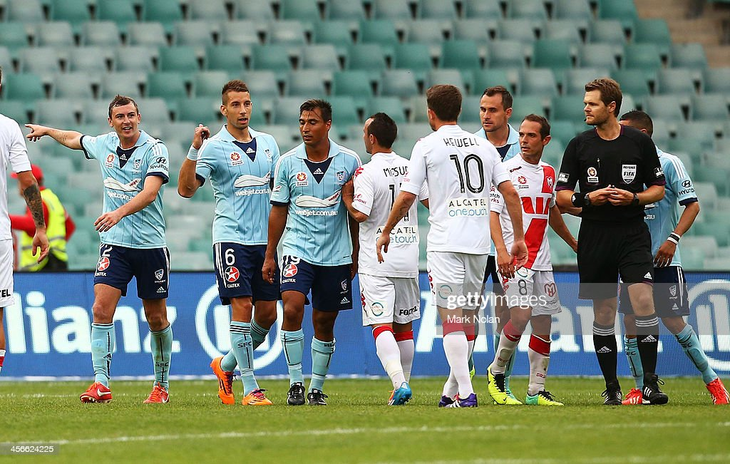 Sydney FC players taunt Harry Kewell after he missed a penalty shot at goal during the round 10 A-League match between Sydney FC and the Melbourne Heart at Allianz Stadium on December 15, 2013 in Sydney, Australia.