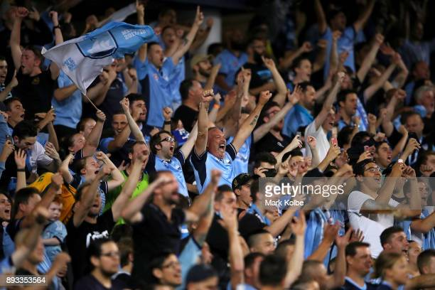Sydney FC supporters celebrate a goal during the round 11 ALeague match between Sydney FC and Melbourne City FC at Allianz Stadium on December 15...