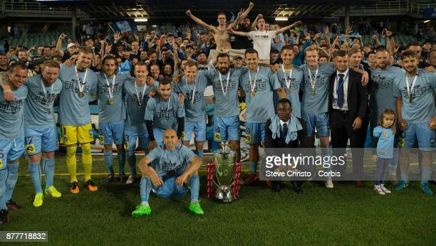 Sydney FC team members stand to have a photo taken in front of the Cove as part of the lap of honour during the FFA Cup Final match between Sydney FC...