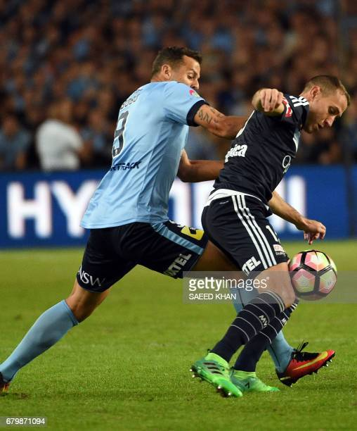 Sydney FC's Bobo fights for the ball with Alan Baro of Melbourne Victory during the 2017 ALeague Grand Final match at Allianz Stadium in Sydney on...