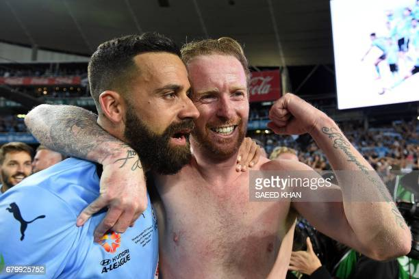 Sydney FC's captain Alex Brosque celebrates the team's win with teammate David Carney in the 2017 ALeague Grand Final football match against...