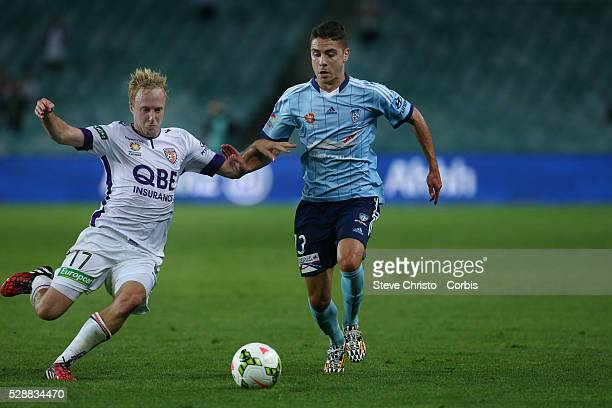 Sydney FC's Christopher Naumoff is tackled by Perth Glory's Mitchell Nichols during the match at Allinaz Stadium Sydney Australia Thursday 4th...