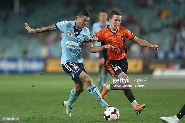 Sydney FC's Corey Gameiro battles for the ball with Brisbane Roars Matthew McKay at Allianz Stadium Sydney Australia Friday 14th March 2014