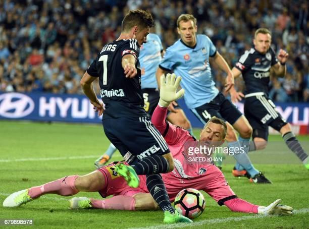 Sydney FC's goalkeeper Daniel Vukovic blocks a shot by Melbourne Victory's Marco Rojas during the 2017 ALeague Grand Final football match at Allianz...