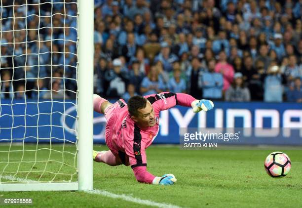 Sydney FC's goalkeeper Daniel Vukovic saves a penalty during the 2017 ALeague Grand Final football match against Melbourne Victory at Allianz Stadium...