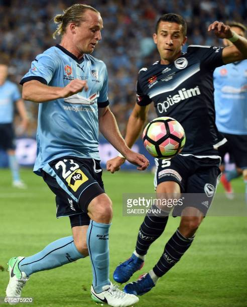 Sydney FC's Rhyan Grant fights for the ball with Melbourne Victory player Daniel Georgievski during the 2017 ALeague Grand Final match at Allianz...