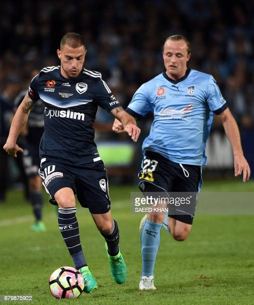 Sydney FC's Rhyan Grant fights for the ball with Melbourne Victory player James Troisi during the 2017 ALeague Grand Final match at Allianz Stadium...