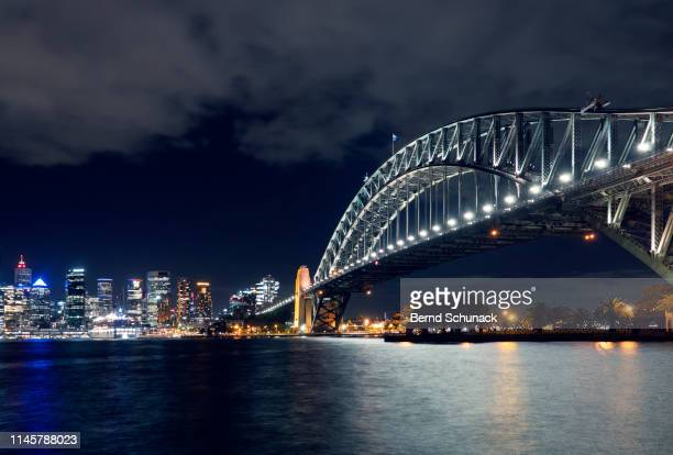 sydney harbor bridge at night - bernd schunack stock photos and pictures