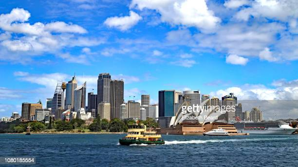 sydney harbor ferry with skyline and opera house - sydney opera house stock pictures, royalty-free photos & images